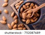 almonds on wooden spoon. top... | Shutterstock . vector #752087689