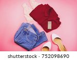 Flat Lay Of Woman Clothes With...