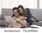 woman hugging her husband while ... | Shutterstock . vector #752109856