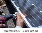 technician is installing solar... | Shutterstock . vector #752112643