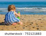 playing in the sand   Shutterstock . vector #752121883
