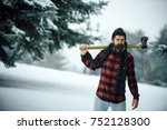 man with beard in winter forest ...   Shutterstock . vector #752128300