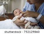 a newborn baby | Shutterstock . vector #752129860