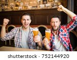 cheerful male friends having... | Shutterstock . vector #752144920