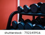 rows of dumbbells in the gym | Shutterstock . vector #752145916