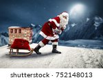 crazy santa claus on a sledge.... | Shutterstock . vector #752148013