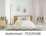 bright feminine bedroom with... | Shutterstock . vector #752150188