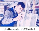 serious adult production worker ... | Shutterstock . vector #752159374