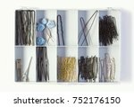 fixing hair  pins in a plastic... | Shutterstock . vector #752176150