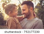 father and daughter share love.  | Shutterstock . vector #752177230