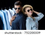 happy young couple trying on... | Shutterstock . vector #752200339