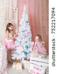 two sisters in a christmas... | Shutterstock . vector #752217094