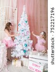 two sisters in a christmas... | Shutterstock . vector #752217196