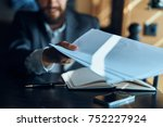 documents in the hand of a... | Shutterstock . vector #752227924