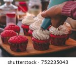 person decorates cupcakes with... | Shutterstock . vector #752235043