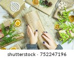 a woman wraps a gift in a white ... | Shutterstock . vector #752247196