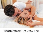 sensual foreplay by couple | Shutterstock . vector #752252770