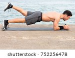 athletic man during forearm... | Shutterstock . vector #752256478