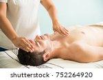 female therapist using her... | Shutterstock . vector #752264920