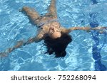 relaxed woman inside the pool  | Shutterstock . vector #752268094