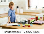 cute child learning to become a ... | Shutterstock . vector #752277328