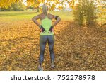 athletic young woman rubbing... | Shutterstock . vector #752278978