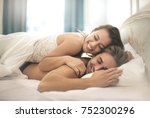 sweet couple cuddling in the... | Shutterstock . vector #752300296