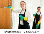 happy women workers cleaning... | Shutterstock . vector #752309374