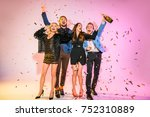 happy stylish friends with...   Shutterstock . vector #752310889