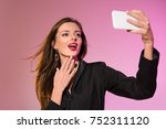 stylish attractive woman taking ... | Shutterstock . vector #752311120