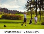 boy practice golf with his... | Shutterstock . vector #752318593