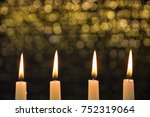 four burning candles on the... | Shutterstock . vector #752319064