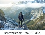 man hiker with a backpack on...   Shutterstock . vector #752321386
