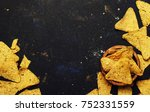 nachos in wooden bowl  black... | Shutterstock . vector #752331559
