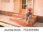 young man holding a little dog... | Shutterstock . vector #752355484