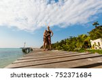Small photo of Summer landscape on tropical koh Kood island in Thailand. Beautiful young couple and landscape with sea taken on Klong Mard.