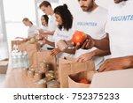 group of multiethnic volunteers ... | Shutterstock . vector #752375233