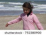 young girl walking on the beach ... | Shutterstock . vector #752380900