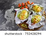 potatoes in foil with spices... | Shutterstock . vector #752428294