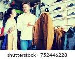 positive couple choosing new...   Shutterstock . vector #752446228
