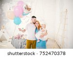 a young family of three people  ... | Shutterstock . vector #752470378