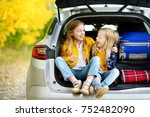 two adorable girls sitting in a ... | Shutterstock . vector #752482090