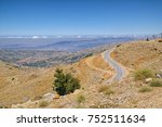 Small photo of A view over Golan Heights from Mount Hermon, the highest point in Israel, with typical seasonal lack of greenery due to hot sun and absence of rains.