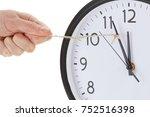 holding minute hand of alarm... | Shutterstock . vector #752516398