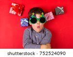 cute boy surrounded by various... | Shutterstock . vector #752524090