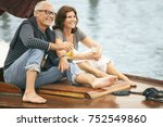 middle aged couple drinking on... | Shutterstock . vector #752549860