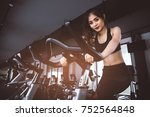 asian fitness woman on bicycle... | Shutterstock . vector #752564848