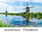 windmills across and reflected... | Shutterstock . vector #752568103