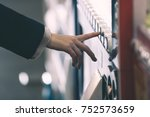 woman buying with a vending... | Shutterstock . vector #752573659