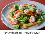 fried shrimp and vegetables in... | Shutterstock . vector #752594224